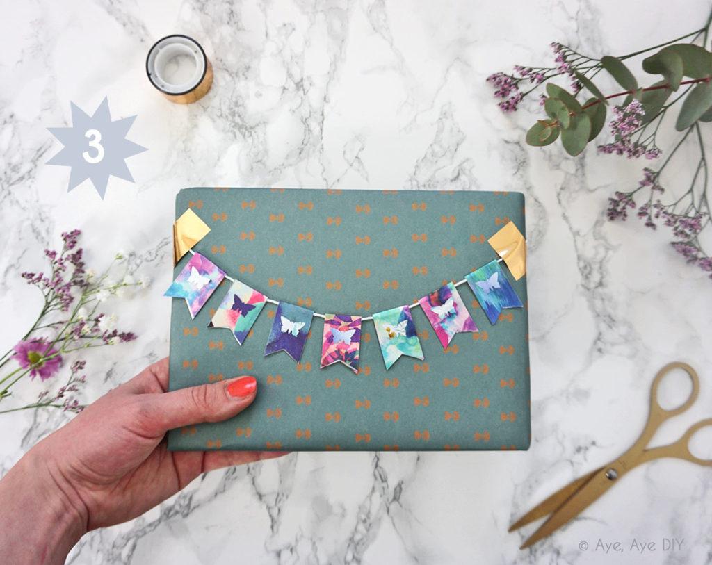 Geschenkpapier mit Wimpelkette
