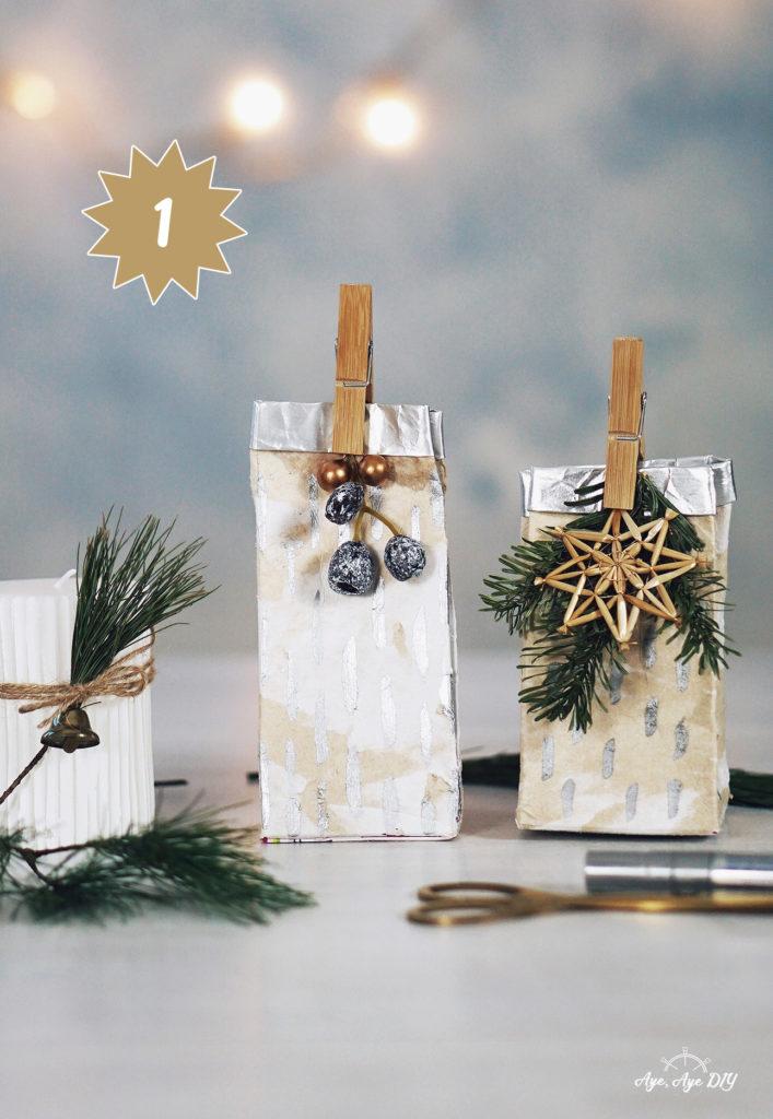 DIY Geschenktüte aus altem Milchkarton mit Silberfarbe und Anhängern
