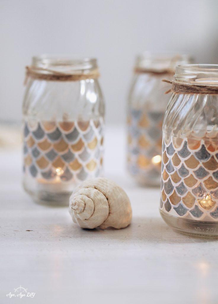 Windlicht selber machen Glas dekorieren bemalen mit Fischschuppenmuster